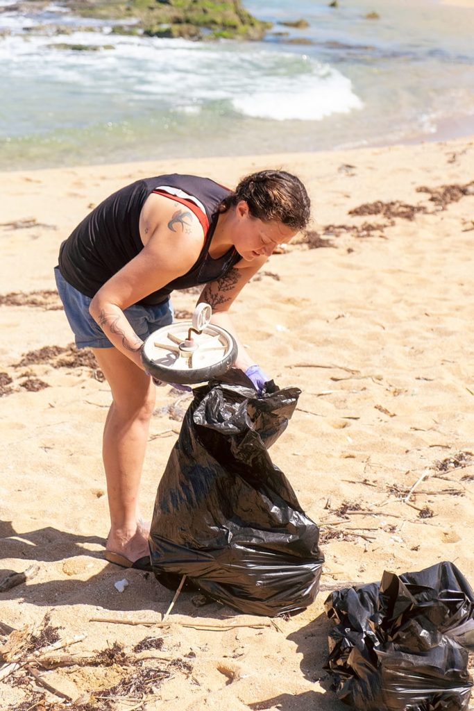 Louis picking up trash